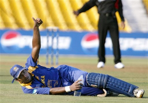 Sri Lankan cricketer Kumar Sangakkara displays a thumbs up after he was declared not out after an appeal by Zimbabwe during the ICC Champions Trophy's qualifying match in Ahmedabad on Tuesday.