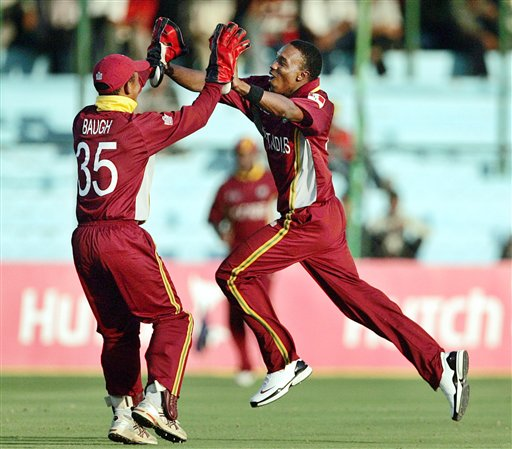 West Indies cricketer Dwayne Bravo, right, and wicket keeper Carlton Baugh celebrate the dismissal of Bangladesh's Mashrafe Mortaza, unseen, during the one-day international cricket match for the ICC Champions Trophy in Jaipur on Wednesday.