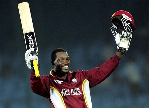 West Indies cricketer Chris Gayle celebrates his century, during the one-day international cricket match against Bangladesh for the ICC Champions Trophy in Jaipur on Wednesday.