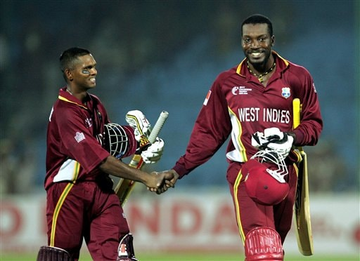 West Indies cricketers Shivnarine Chanderpaul, left, and Chris Gayle, congratulate each other after beating Bangladesh during the one-day international cricket match for the ICC Champions cricket match in Jaipur on Wednesday.