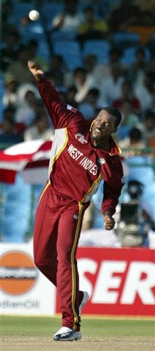 West Indies cricketer Chris Gayle bowls during the match against Bangladesh at the ICC Champions Trophy qualifying match in Jaipur on Wednesday.