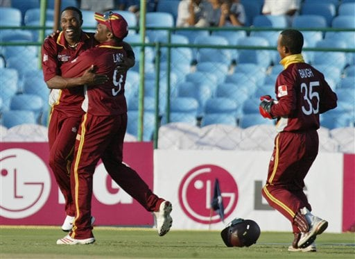 West Indies cricket captain Brian Lara, second left, congratulates Dwayne Bravo, left, as wicket keeper Carlton Baugh, joins in after the dismissal of Bangladesh's Masharafe Bin Mortaza, unseen, during the ICC Champions Trophy qualifying match in Jaipur on Wednesday.