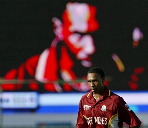 West Indies cricketer Dwayne Bravo looks on as he is shown on a giant screen in the background, during the match against Bangladesh at the ICC Champions Trophy qualifying match in Jaipur on Wednesday.