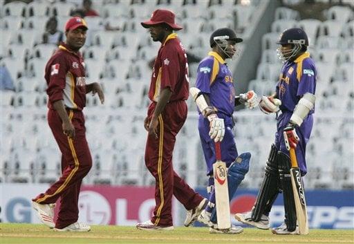 Sri Lankan batsmen Mahela Jayawardene, right, and Sanath Jayasuriya, second right, talk during their unbeaten partnership against West Indies during the ICC Champions Trophy cricket match in Mumbai on Saturday.