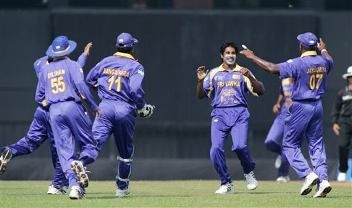 Sri Lankan bowler Chaminda Vaas, second right, rejoices along with team members after the dismissal of West Indies' Chris Gayle, unseen, during their Champion's Trophy match in Mumbai on Saturday.