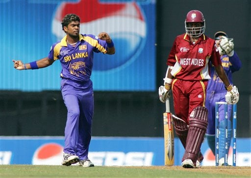 Sri Lankan bowler Lasith Malinga, left, reacts after dismissing West Indian Shivnarine Chanderpaul, right, during their Champion's Trophy match in Mumbai on Saturday.