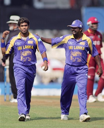 Sri Lankan bowler Lasith Malinga, left, is complimented by Muttiah Muralitharan after he dismissed West Indian Shivnarine Chanderpaul, unseen, during their Champion's Trophy match in Mumbai on Saturday.