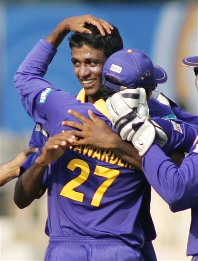 Sri Lankan bowler Farveez Maharoof, center facing camera, is congratulated by captain Mahela Jayawardene after dismissing a West Indian batsman during their Champion's Trophy cricket match in Mumbai on Saturday.