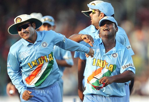 India's Ramesh Powar, right and Virender Sehwag celebrate the dismissal of England's James Anderson, unseen, during the one day international cricket match for the ICC Champions Trophy in Jaipur on Sunday.