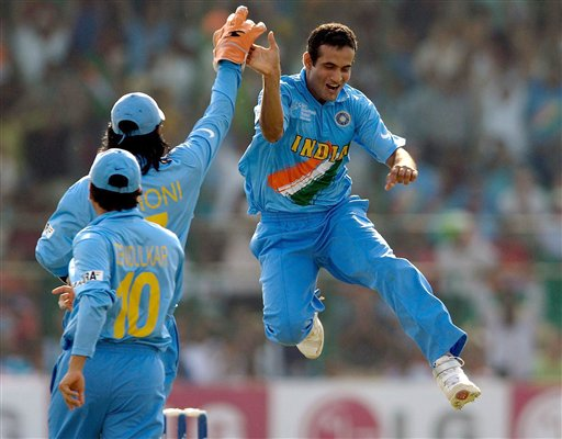 India's Irfan Pathan, right, celebrates taking the wicket of England's Andrew Strauss during the ICC Champions Trophy cricket match in Jaipur on Sunday.