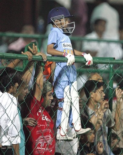 A young cricket fan fully dressed in players' gear watches Indias one day international cricket match against England for the ICC Champions Trophy in Jaipur on Sunday.
