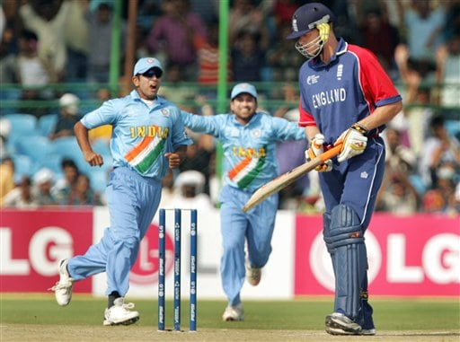 England's Andrew Flintoff, right, reacts as India's Rahul Dravid, left, and Sachin Tendulkar celebrate his dismissal during the one day international cricket match for the ICC Champions Trophy in Jaipur on Sunday.