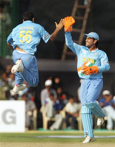 India's Irfan Pathan, left, and Mahendra Singh Dhoni celebrate the dismissal of England's Andrew Strauss, unseen during the one day international cricket match for the ICC Champions Trophy in Jaipur on Sunday.