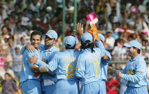 Irfan Pathan of India, left, is congratulated by teammates after he took the wicket of England's Andrew Strauss, unseen, during the one-day international cricket match for the ICC Champions Trophy in Jaipur on Sunday.