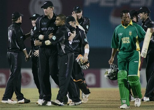 New Zealand cricketer, Jacob Oram, third left, hugs team mate Jeetan Patel, as South Africa's Makhaya Ntini walks back to pavillion in the one-day international cricket match for the ICC Champions Trophy in Mumbai