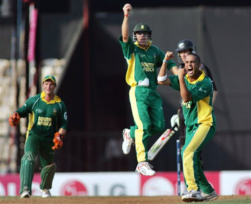 South African bowler Robin Peterson, right, successfully appeals against New Zealand's Jacob Oram in the one-day international cricket match for the ICC Champions Trophy in Mumbai, India, Monday, Oct. 16, 2006. Leaping in the air is Boeta Dippenaar, who took the catch, and on the left is Mark Boucher