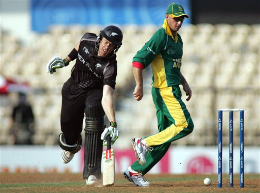 New Zealand batsman Jacob Oram, left, grounds his bat after South African fielder Herschelle Gibbs kicked the ball to try and hit the stumps in the one-day international cricket match for the ICC Champions Trophy in Mumbai
