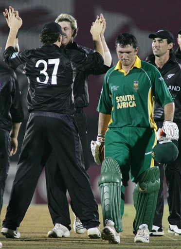 New Zealand's Jacob Oram, left, facing camera, is congratulated by teammate Kyle Mills after he claimed the wicket of South African batsman Graeme Smith, second right, in the one-day international cricket match for the ICC Champions Trophy in Mumbai