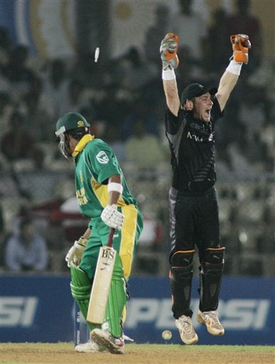 New Zealand wicketkeeper Brendon McCullum, right, leaps up in joy as Brendon McCullum of South Africa is bowled in the one-day international cricket match for the ICC Champions Trophy in Mumbai