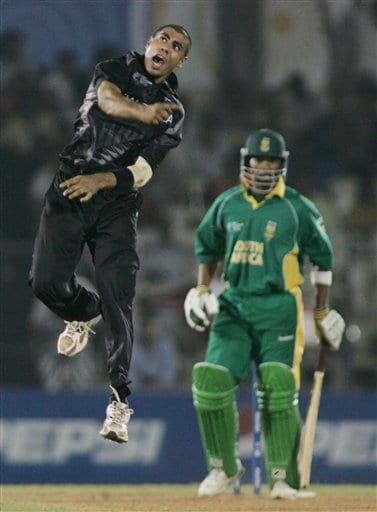 New Zealand cricketer Jeetan Patel leaps in the air to celebrate his third wicket of the match and South Africa's last, that of Makhaya Ntini, right, in the one-day international cricket match for the ICC Champions Trophy in Mumbai