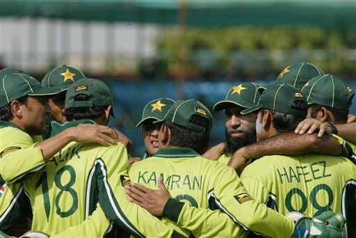 Pakistan cricketers huddle after the dismissal of Mahela Jayawardene of Sri Lanka in the one day international cricket match against Sri Lanka for the ICC Champions Trophy in Jaipur on Tuesday.