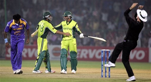 Pakistan's Abdul Razzaq, second right and Shoaib Malik, second left, celebrate their team's victory over Sri Lanka as Umpire Billy Bowden signals for a sixer on the delivery of Sri Lanka's Dilhara Fernando, extreme left, during the one day international cricket match for the ICC Champions Trophy in Jaipur on Tuesday.