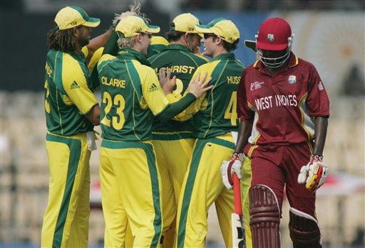 Australian cricket players celebrate the dismissal of West Indies' Wavel Hinds in Mumbai