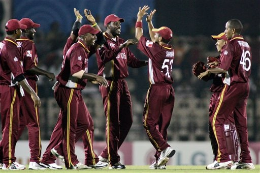 West Indian fielders celebrate the fall of Damien Martyn's wicket as they play against Australia in the one day international cricket match in the ICC Champions Trophy in Mumbai