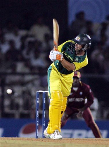 Australian batsman Adam Gilchrist plays a ball on the on side for four against West Indies in the one day international cricket match in the ICC Champions Trophy in Mumbai