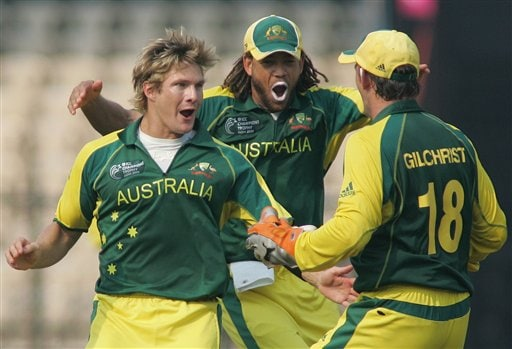 Australian cricket players Adam Gilchrist, right, Andrew Symonds, second right, congratulate Shane Watson after he claimed the wicket of West Indies' Chris Gayle in Mumbai