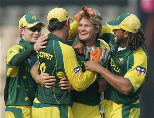 Australian cricket players Andrew Symonds, right, Adam Gilchrist, second left, and Michael Clarke, left, congratulate Shane Watson after he claimed the wicket of West Indies' Chris Gayle in Mumbai