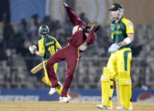 Chris Gayle of West Indies, center, reacts after running out Australian batsman Adam Gilchrist, left, in the one day international cricket match in the ICC Champions Trophy in Mumbai