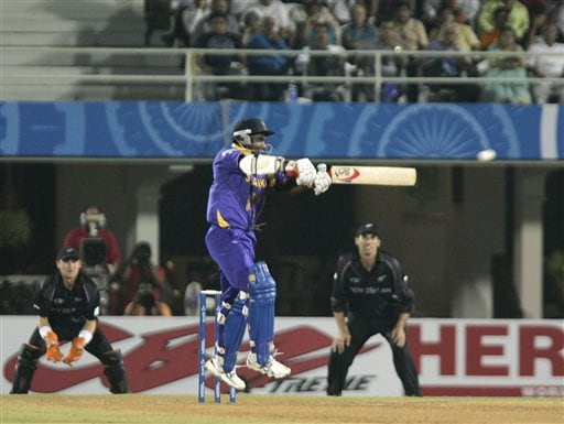 Sri Lankan batsman Sanath Jayasuriya scores a four off New Zealand's Shane Bond during their one-day international cricket for the ICC Champions Trophy in Mumbai on Friday.
