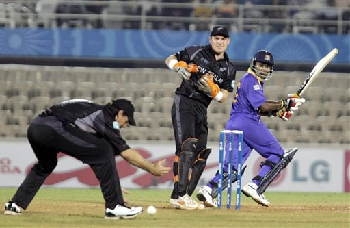 Sri Lankan cricket Captain Mahela Jayawardene cuts a ball as New Zealand's Stephen Fleming tries to stop it during the one-day international cricket for the ICC Champions Trophy in Mumbai on Friday.