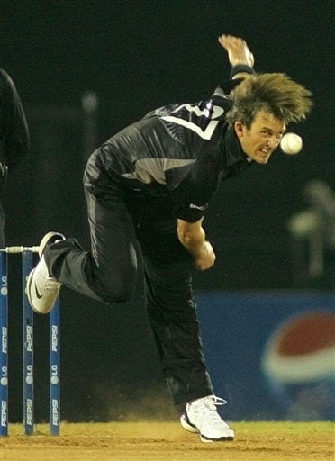 New Zealand 's Shane Bond bowls against Sri Lanka during the Champions trophy cricket match in Mumbai on Friday.