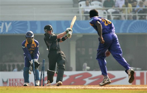 New Zealand's Lou Vincent is bowled by Sri Lanka's Farveez Maharoof as wicketkeeper Kumar Sangakkara, right, looks on during their one-day cricket match for the ICC Champions Trophy in Mumbai on Friday.