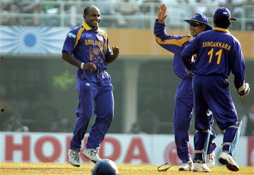 Sri Lankan bowler Sanath Jayasuriya, left, celebrates the dismissal of New Zealand's Scott Styris during the one-day international cricket match for the ICC Champions Trophy in Mumbai on Friday.