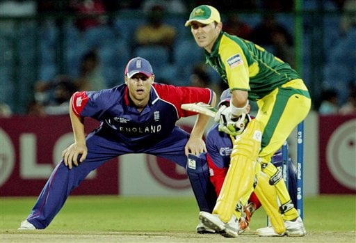 Australian cricketer Damien Martyn, right, prepares to play a shot, as England's Andrew Flintoff looks on during the one-day international cricket match for the ICC Champions Trophy in Jaipur, India, Saturday, October 21, 2006. (AP Photo/Aman Sharma)