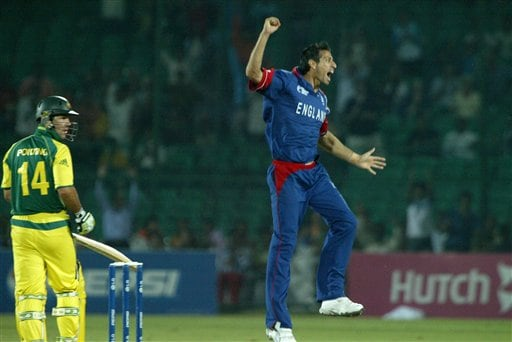England's cricketer Sajid Mahmood jumps as he celebrates the dismissal of Australian Captain Ricky Ponting, left, during the one-day international cricket match against England for the ICC Champions Trophy in Jaipur, India, Saturday, October 21, 2006. (AP Photo/Bikas Das)