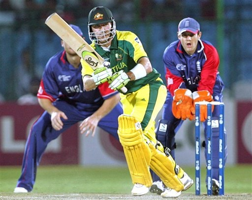 Australia's Damien Martyn, centre, plays a shot as England's wicket keeper Chris Read, right, looks on during the one-day international cricket match for the ICC Champions Trophy in Jaipur, India, Saturday, October 21, 2006. (AP Photo/Aman Sharma)