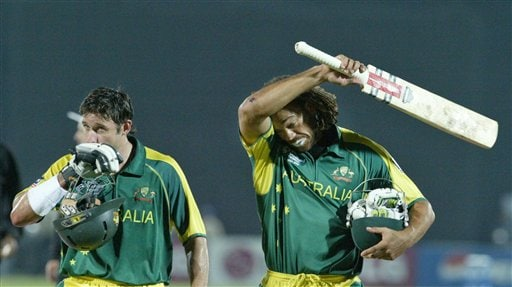 Australian cricketers Andrew Symonds, right, and Michael Hussy walk towards the pavilion after winning the match against England by 6 wickets during the ICC Champions Trophy in Jaipur, India Saturday, October 21, 2006. (AP Photo/Bikas Das)