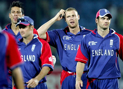 England's cricket Captain Andrew Flintoff, second right, James Anderson, right and Sajid Mahmood, left, walk towards the pavilion after losing to Australia during the one-day international cricket match for the ICC Champions Trophy in Jaipur, India, Saturday, October 21, 2006. (AP Photo/Aman Sharma)