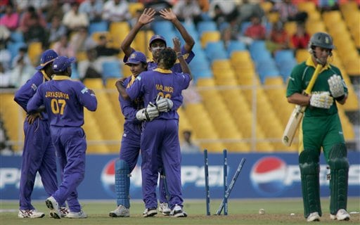 Sri Lankan players celebrate as Mark Boucher of South Africa departs after being bowled by Sri Lankan bowler Lasith Malinga in Ahmadabad on Tuesday.