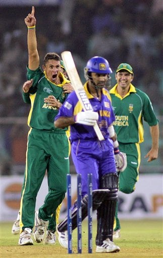 South African bowler Andre Nel, left, celebrates after Sri Lankan batsman Marvan Atapattu, center, was bowled by him during their match in the ICC Champions Trophy in Ahmadabad on Tuesday.