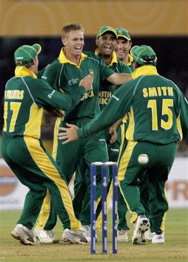 South Africa's Shaun Pollock, second left, celebrates along with captain Graeme Smith, right, and team mates after dismissing Sri Lanka's Kumar Sangakkara, unseen, in the ICC Champions Trophy cricket tournament match in Ahmadabad on Tuesday.