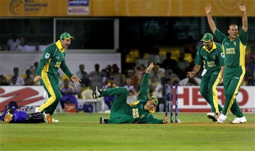South Africa's Shaun Pollock, center, celebrates along with team mates after dismissing Sri Lanka's captain Mahela Jayawardene, left on ground, in the ICC Champions Trophy cricket tournament match in Ahmadabad on Tuesday.