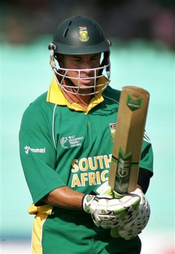 South African cricketer Herschelle Gibbs looks at his bat after being declared out against Sri Lanka in Ahmadabad on Tuesday.