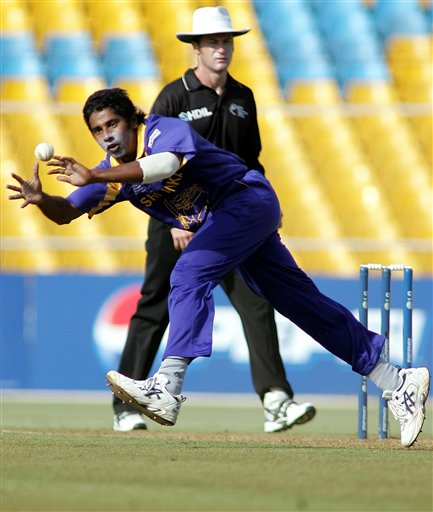 Sri Lankan cricketer Chaminda Vaas fields off his own bowling while playing against South Africa in Ahmadabad on Tuesday.