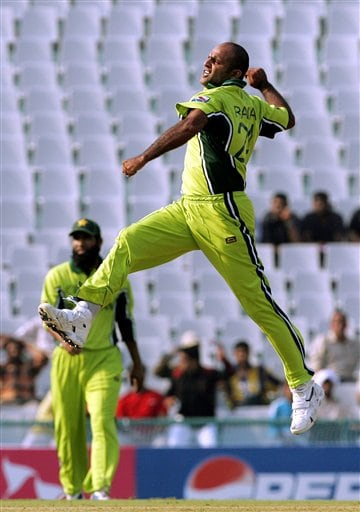 Pakistan's Rana Naveed celebrates the dismissal of New Zealand's Nathan Astle, unseen, during the one day international cricket match for the ICC Champions Trophy in Mohali
