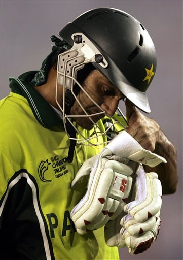 Pakistans's Muhammad Hafeez reacts after New Zealand's Jacob Oram took his wicket during the one day international cricket match for the ICC Champions Trophy in Mohali